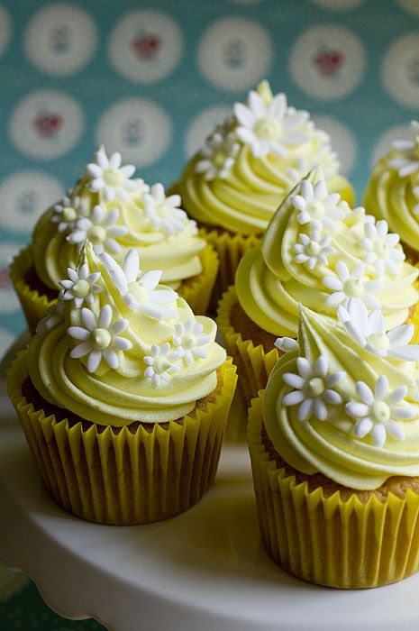 White Floral Yellow Cupcakes